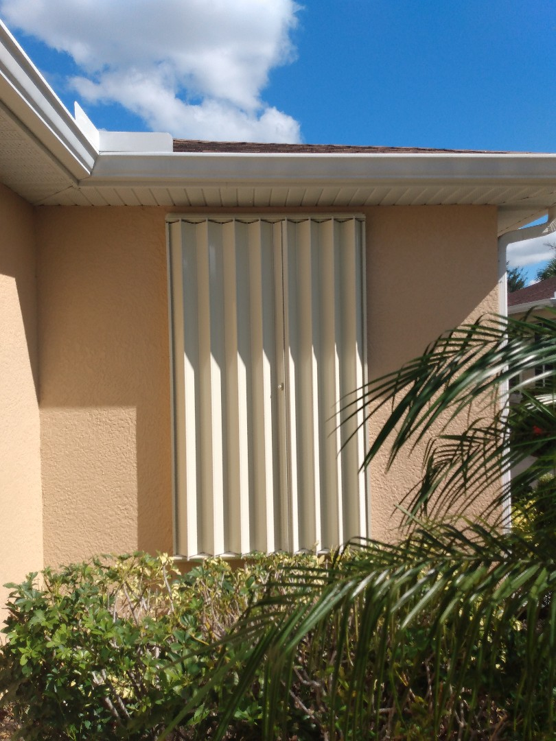 Accordion hurricane shutters