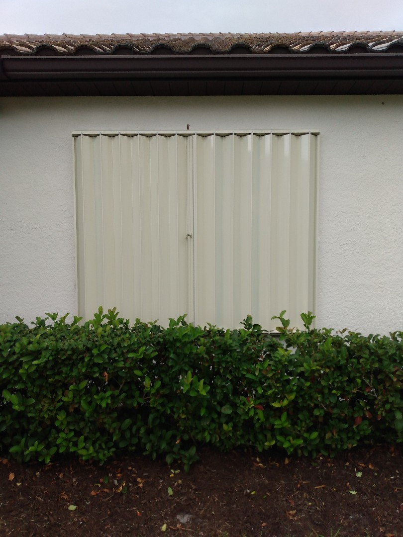 Accordion hurricane shutters