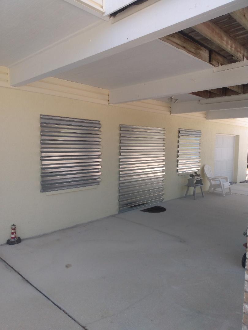 Steel hurricane panels