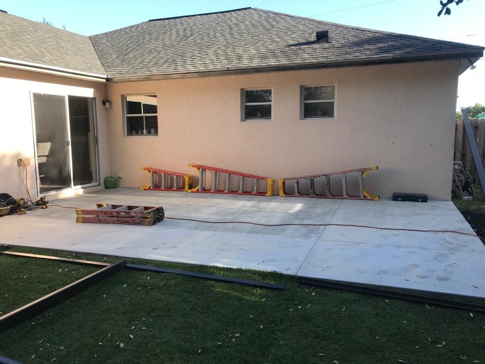 Installing new elite roof and back lanai Harper's 1980 LLC