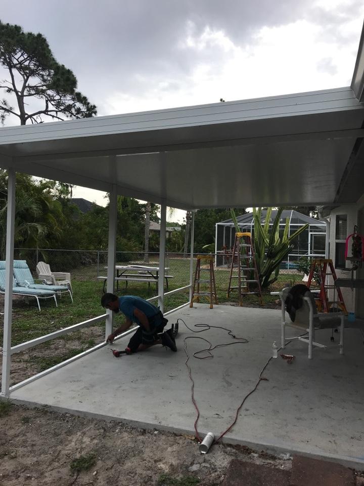 Installing. Elite roof on back of house harpers 1980 LLC