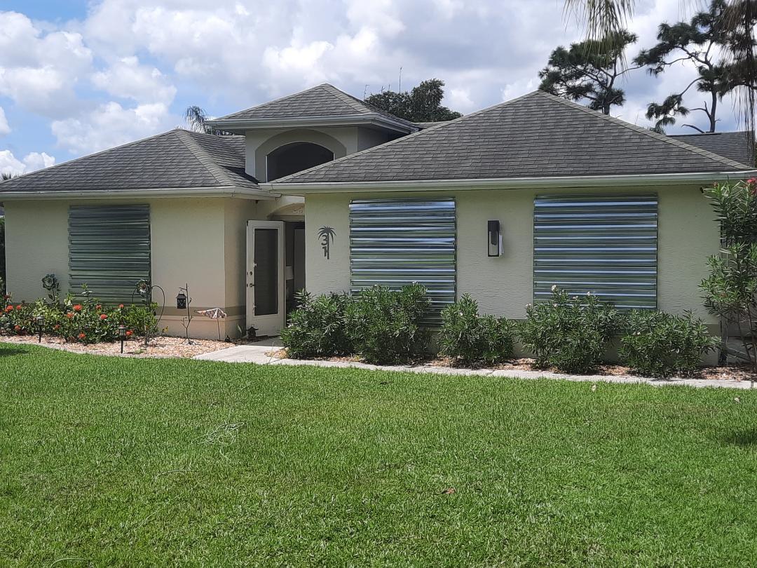 Install hurricane panel shutters