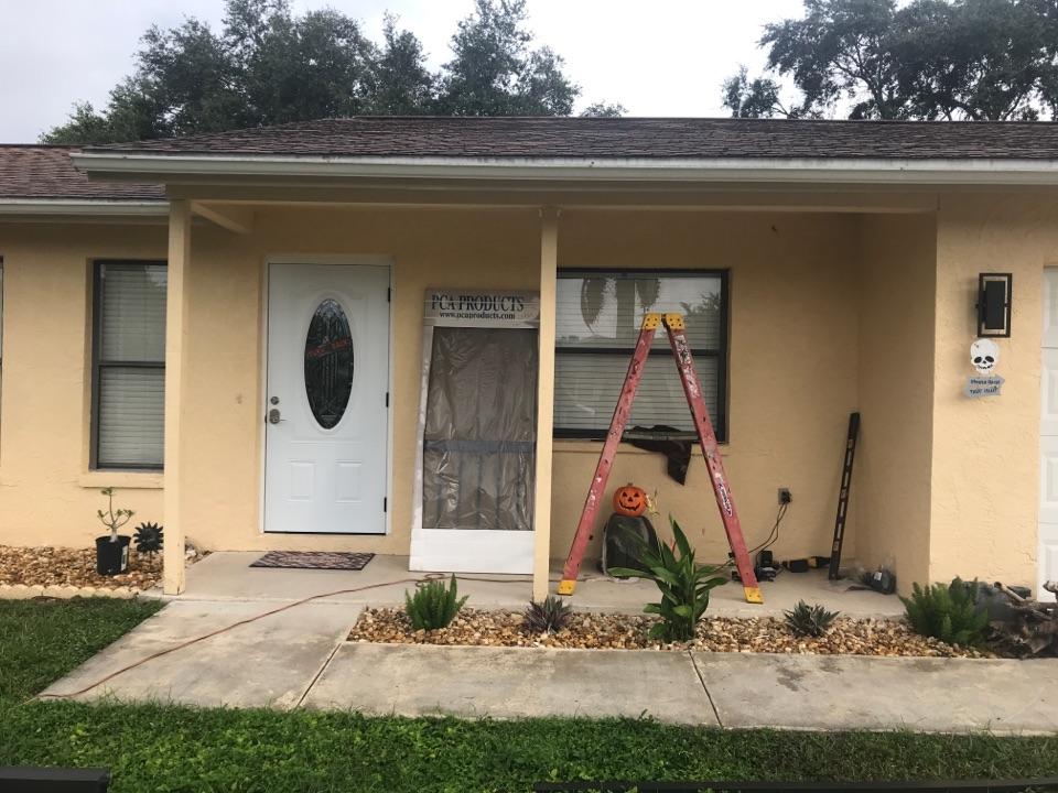 Installing new front entryway color bronze Harpers 1980 LLC