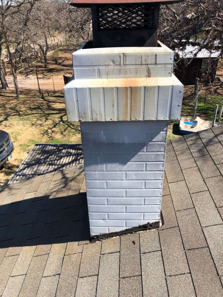 Marble Falls, TX - Quoting a repair on a leaking chimney in granite shoals.