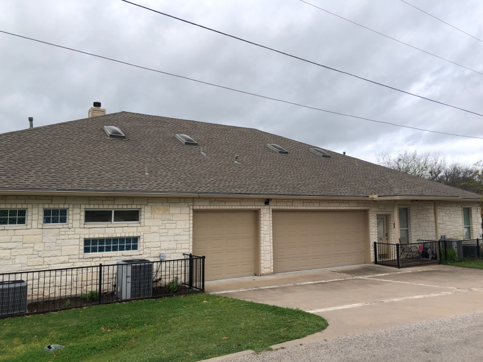 Kingsland, TX - Writing up a gutter and roof repair for a laminated shingle home I kingsland