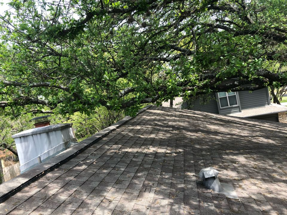 Austin, TX - Quoting a roof replacement and gutter installation on a house in Austin today