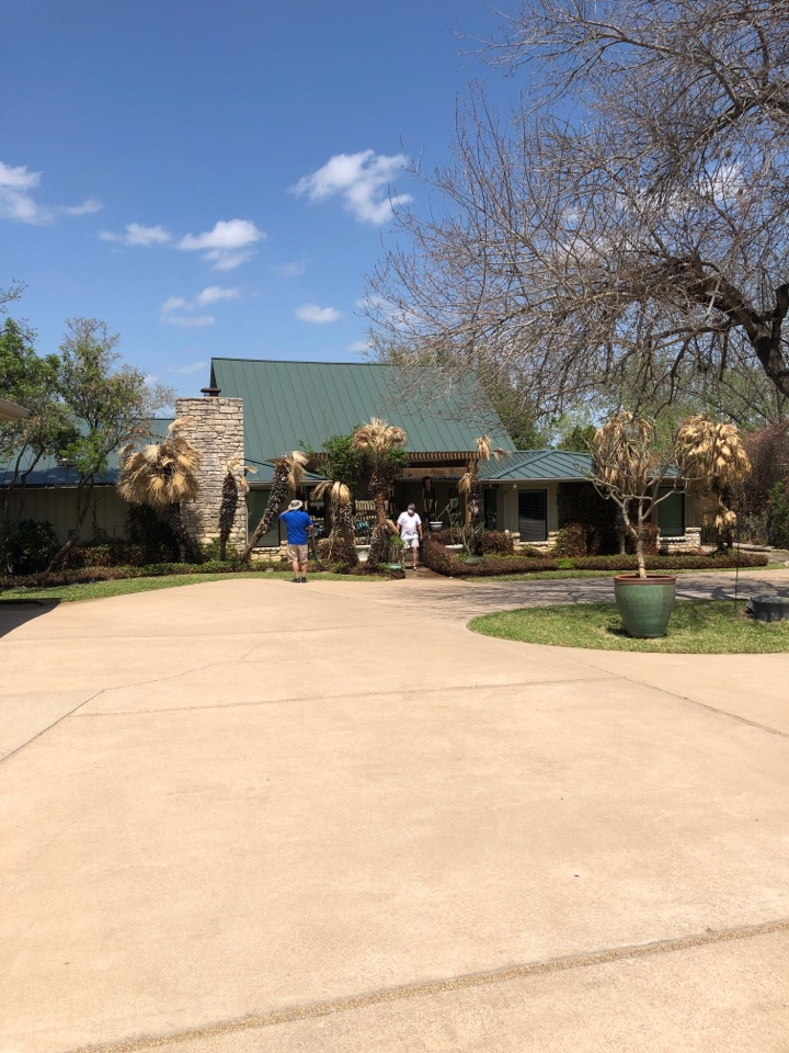 Cottonwood Shores, TX - Writing up a gutter quote on a metal roofed home in HSB