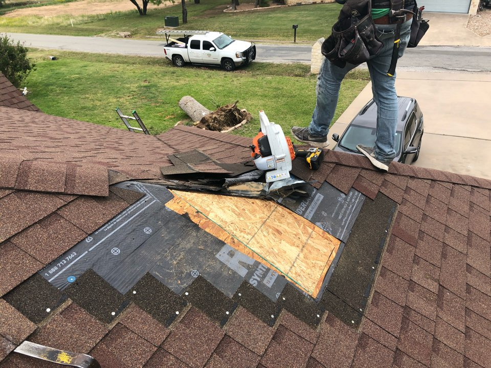 Kingsland, TX - Customers roof was struck by lightning, blowing a hole in it. Removed and replaced shingles and put in new decking.
