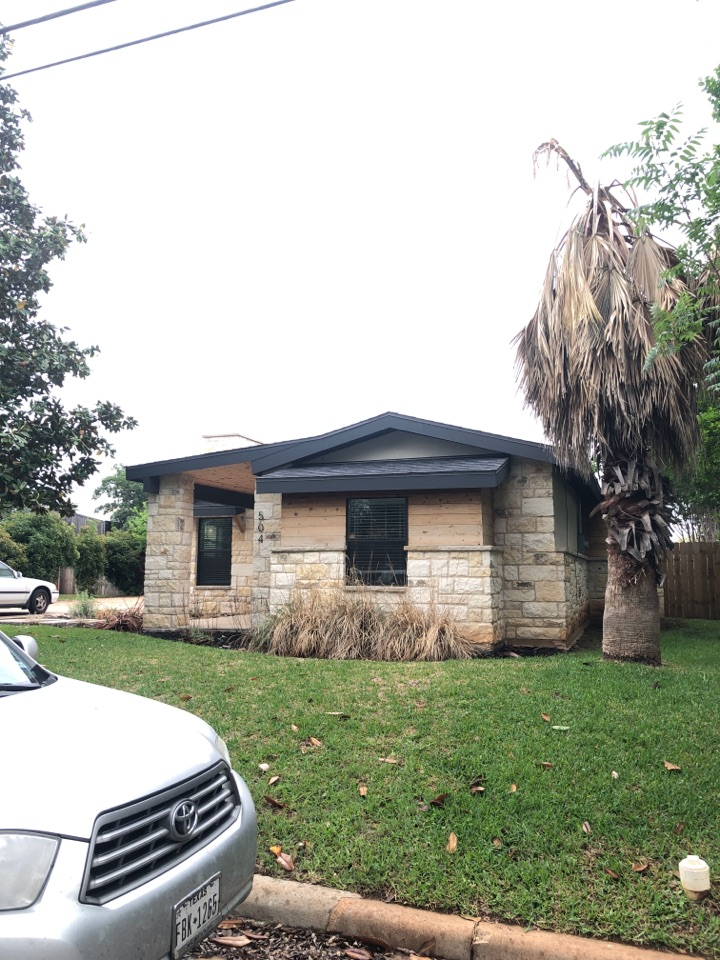 Llano, TX - Inspecting a black laminated shingle roof for hail damage in llano today.