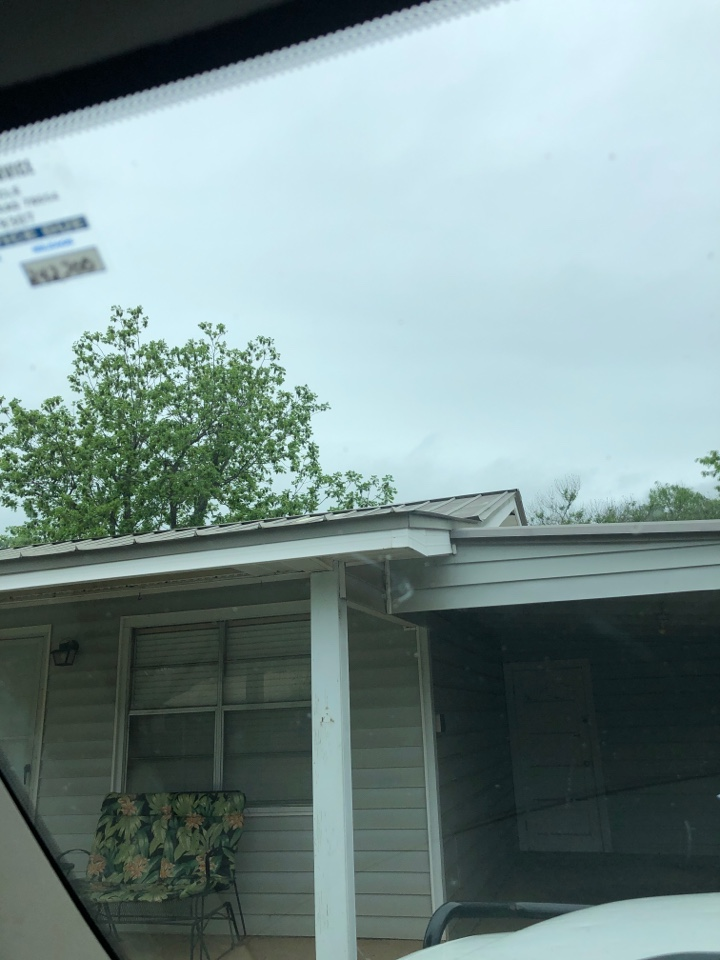 Burnet, TX - Inspecting a metal roof for hail damage in Buchanan dam today.