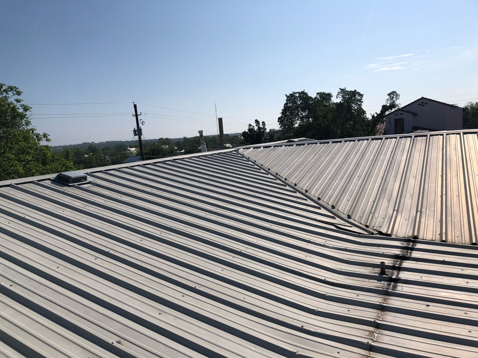 Llano, TX - Inspecting a hail damaged metal roof in llano for replacement today.
