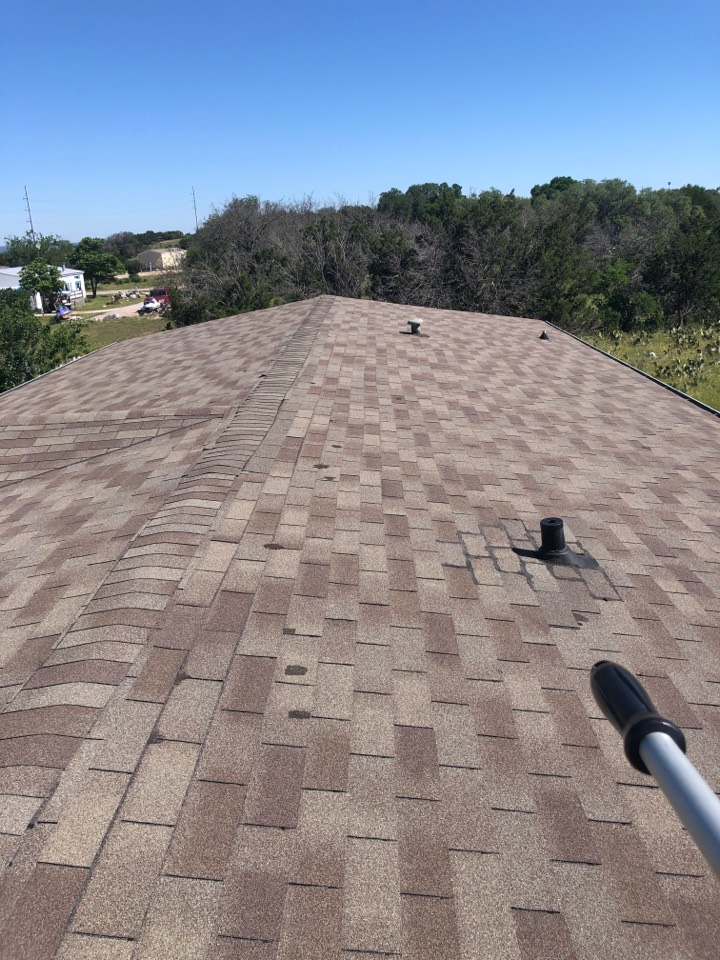 Horseshoe Bay, TX - Leaking 3-tab roof in horseshoe bay that has been previously repaired. Recommend a reroof with laminated shingles instead.