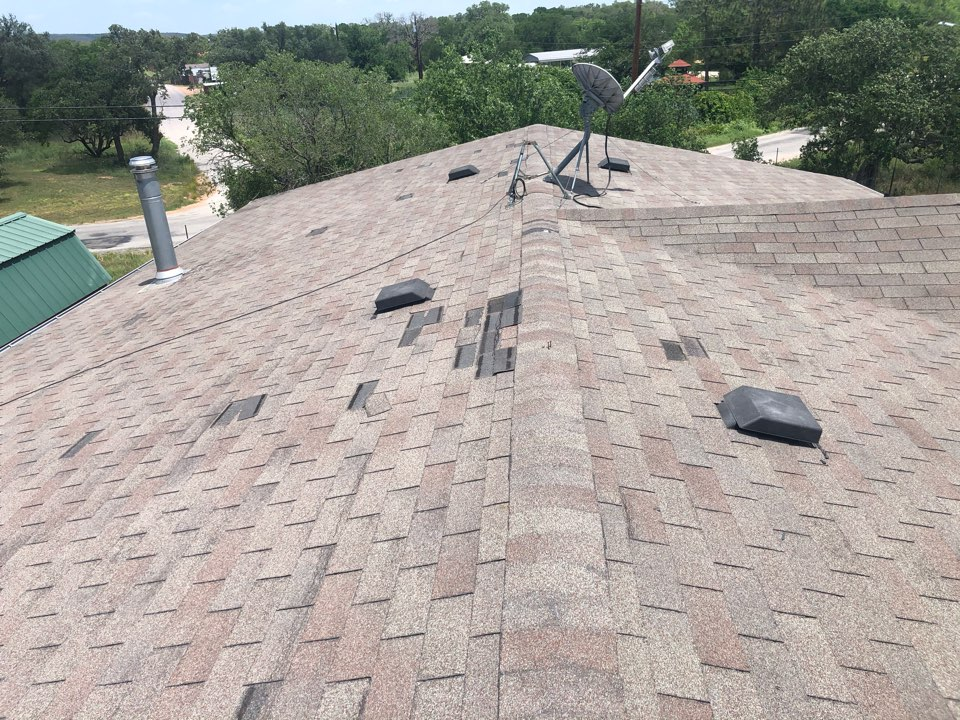 Kingsland, TX - Customer has wind blown shingles on a 3-tab roof. Replacing the entire roof.