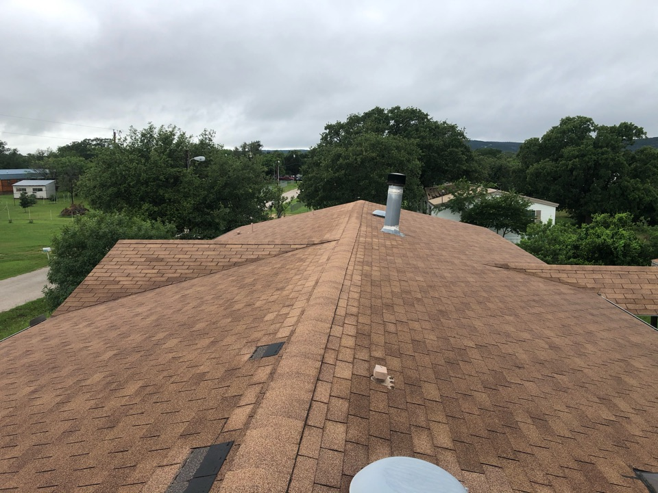 Burnet, TX - Writing up a roof quote to replace a 3-tab system with standing seam.