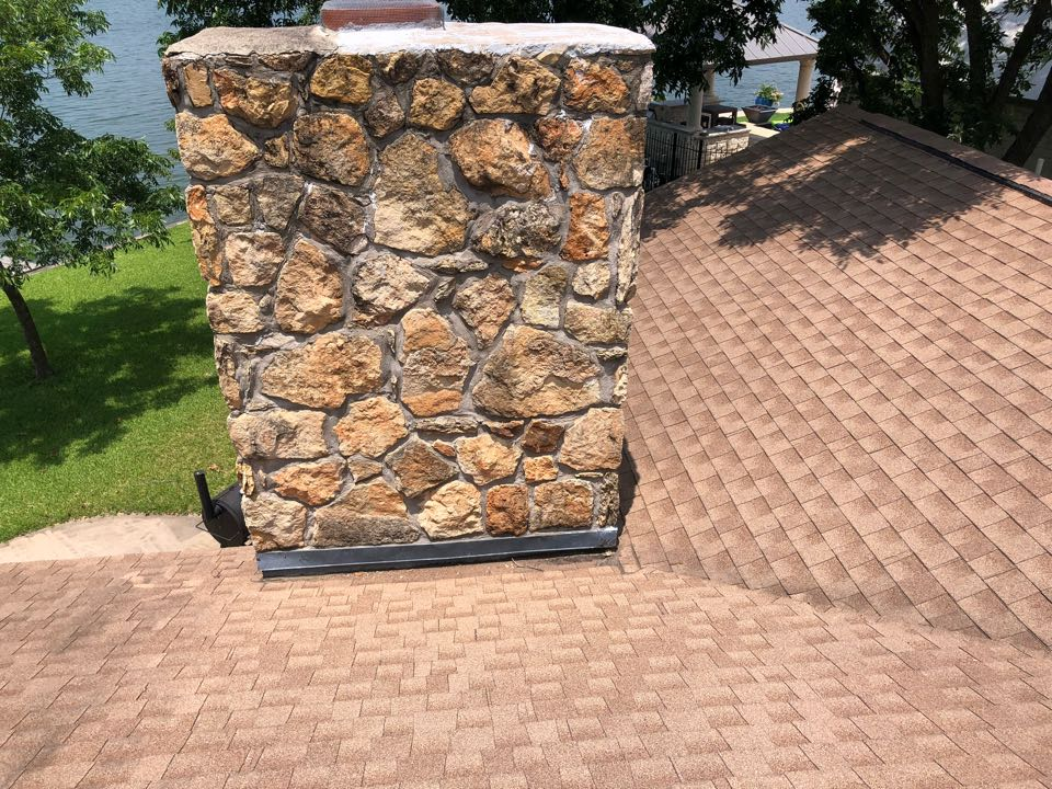 Horseshoe Bay, TX - Inspecting a leaking roof in horseshoe bay. Removing and replacing shingles in work area.