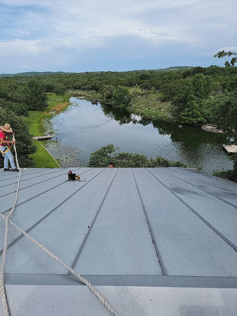 Burnet, TX - Storm damage. Gutter install and roof repair