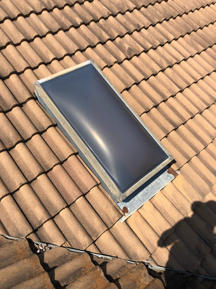 Horseshoe Bay, TX - Looking at a leaking skylight to propose a repair on a tile roof in HSB.