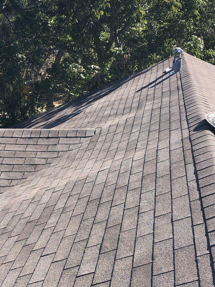 Bertram, TX - Inspecting a 3-tab roof for hail damage in Bertram today.