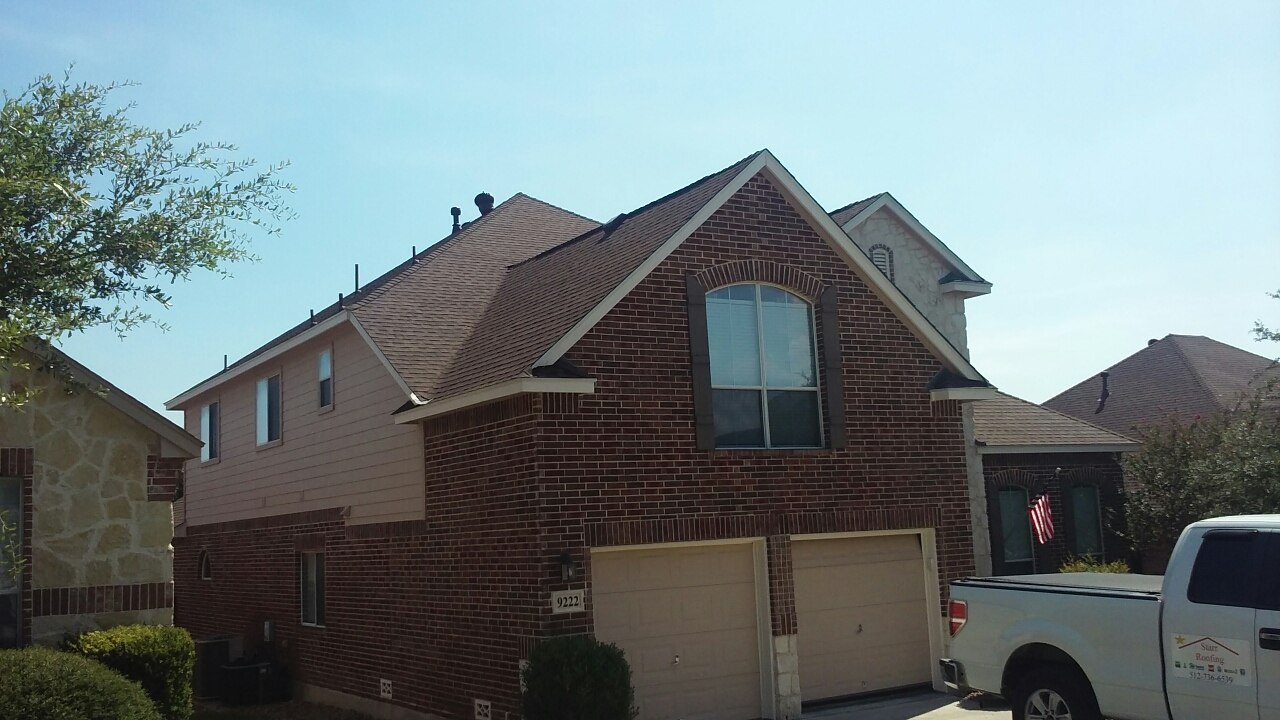 Helotes, TX - Just installed a new GAF high-definition bark wood shingle roof in Helotes Texas due to the recent hail storm