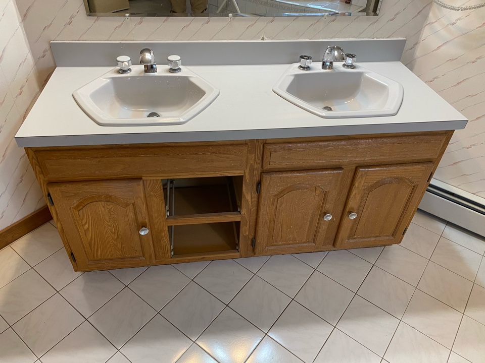 Wallingford, CT - Replacing this older double vanity with a modern vanity, countertop, and faucets.