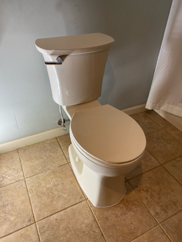Meriden, CT - Replaced a n old toilet with a new American Standard bone colored toilet in the basement of this South Meriden home.