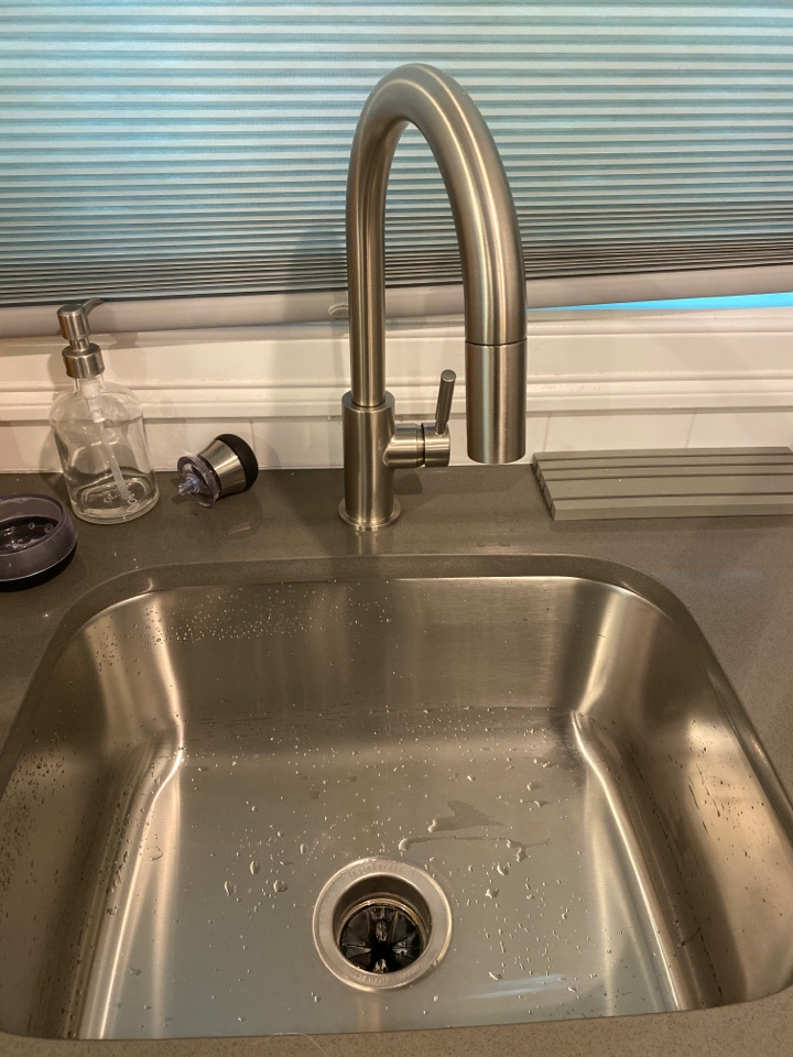 Cheshire, CT - Installed a new Delta faucet and reinstalled the Insinkerator garbage disposal after the customer replaced their countertop.