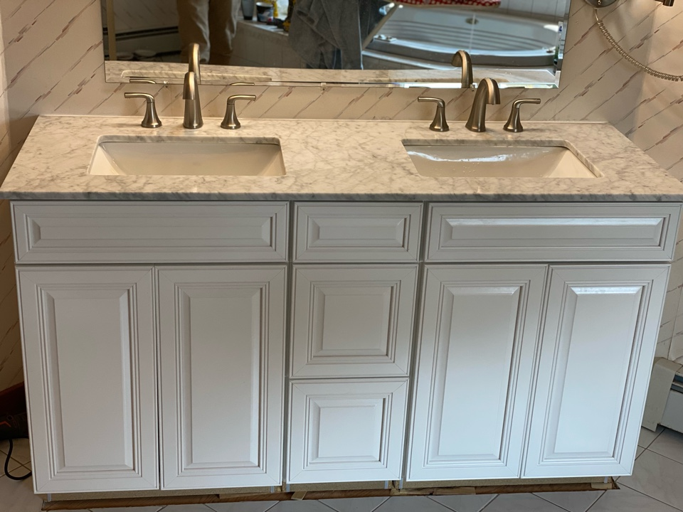 Wallingford, CT - Installation of a new double vanity and Pfister faucet!