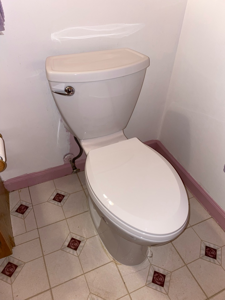 Meriden, CT - Replaced an old toilet with a new American Standard elongated white toilet.