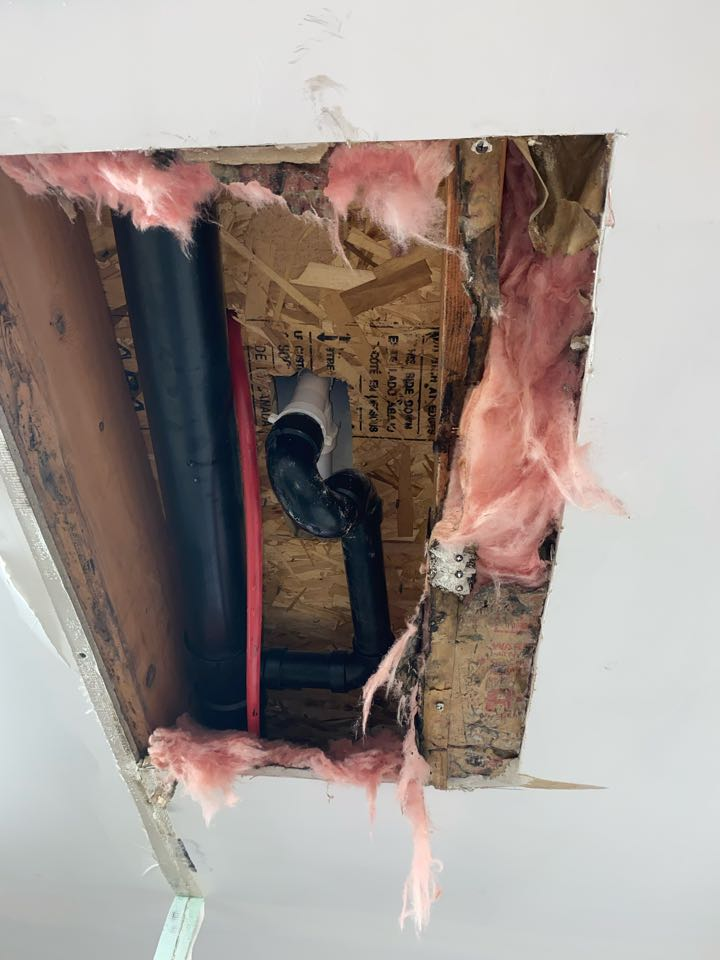 Middletown, CT - Locating a leak causing mold underneath the bathtub. Tub spout not having a seal is causing the water damage in the garage ceiling.