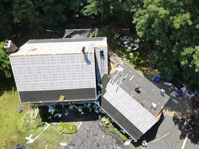 Glastonbury, CT - Roof replacement in progress with GAF Timberline HDZ shingles and EPDM on the shed dormer