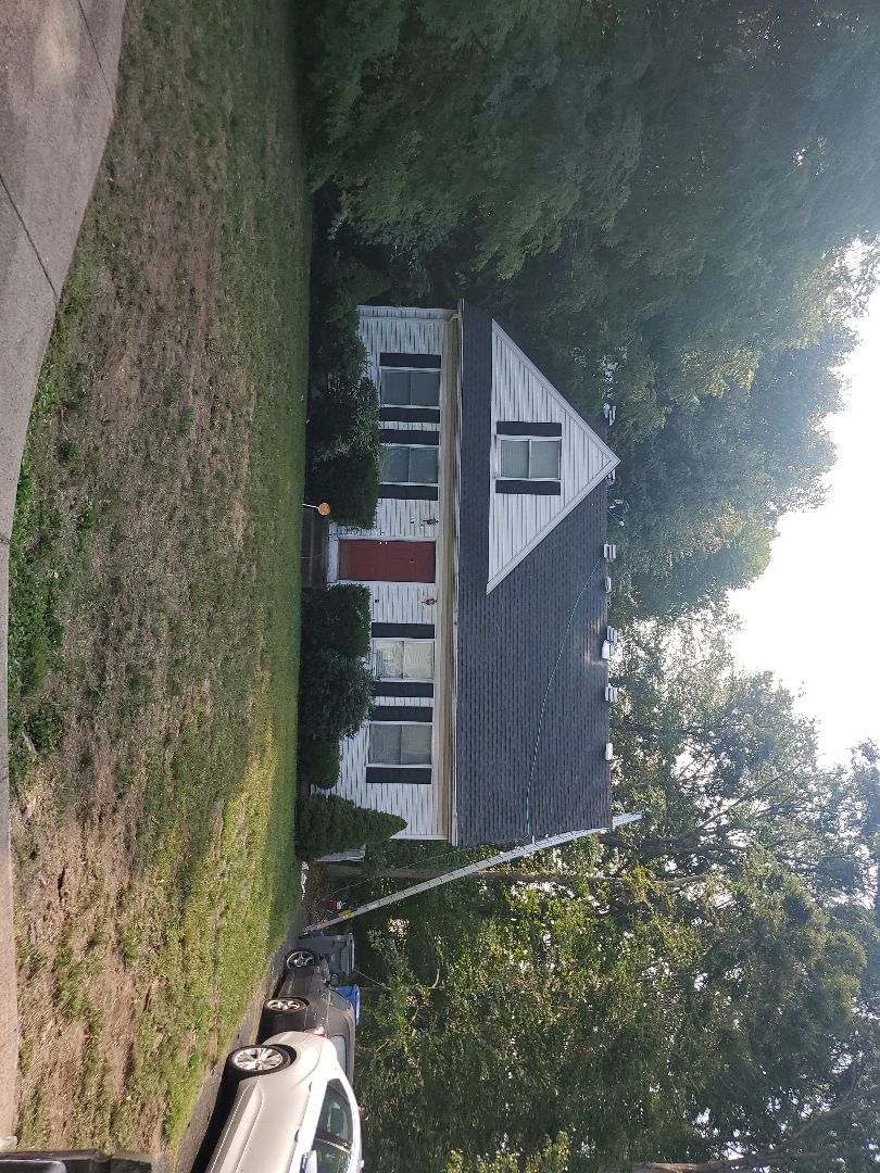 Manchester, CT - New roofing.Charcoal.New siding.White.
