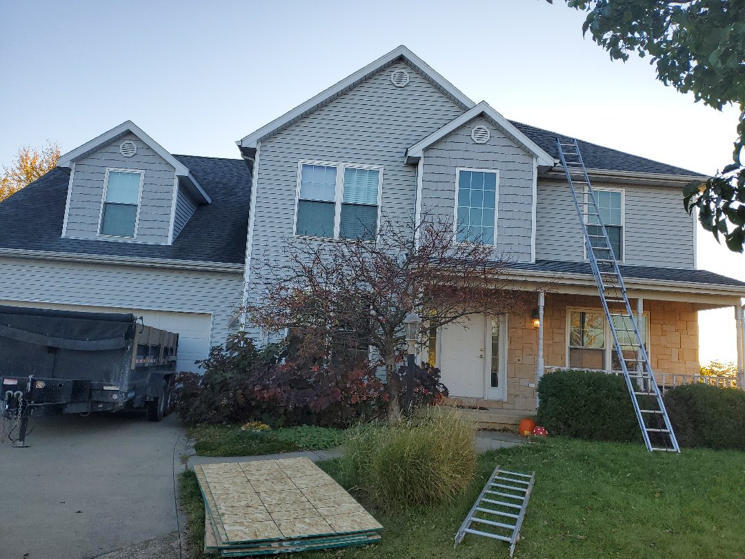 "Urbana, IL - Hail Damage Repairs. Roof replacement with GAF Timberline HDZ Fox Hollow Gray and 5"" seamless gutter replacement."