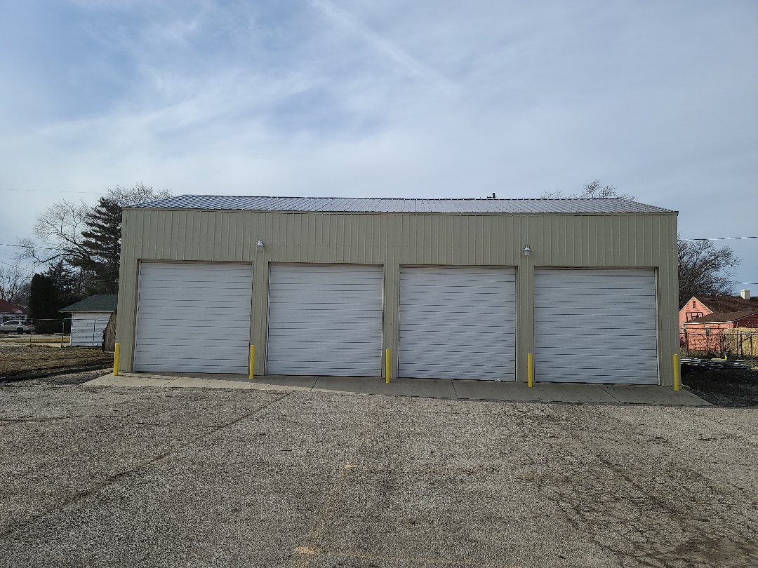 Champaign, IL - Put all new metal roof and metal siding on this building. Insurance approved this whole building due to hail damage. Overhead doors are next