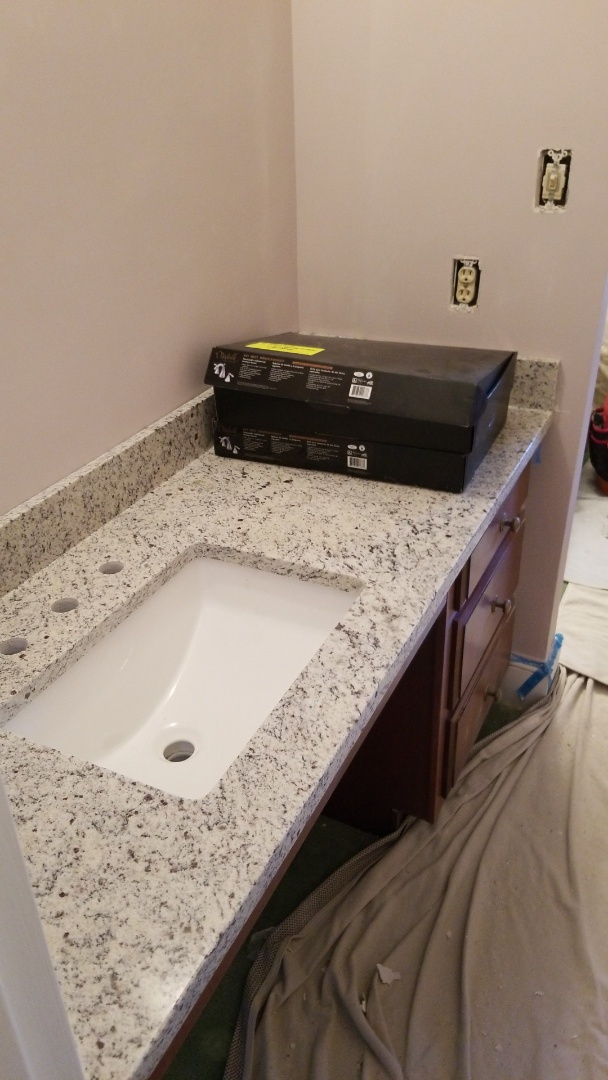 Chevy Chase, MD - Bathroom Remodel with Dallas White Counter tops Level 1 Granite and White Rectangular bathroom sinks