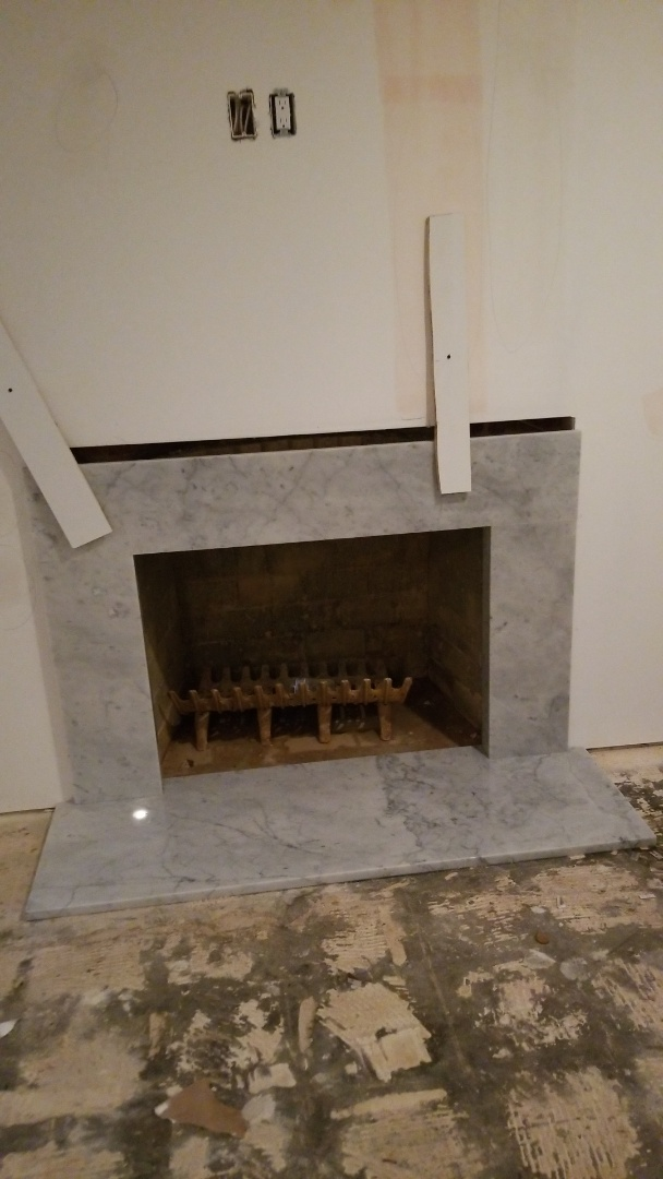 Bethesda, MD - white cararra marble fireplace surround