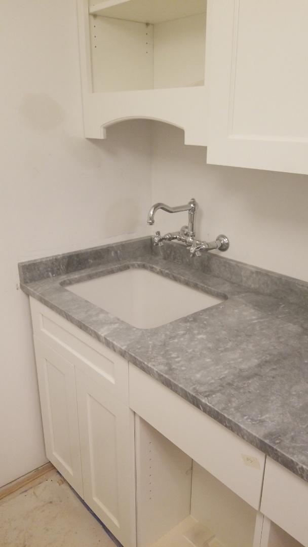 Chevy Chase, MD - Laundry room with undermount sink and Marble - Versilys