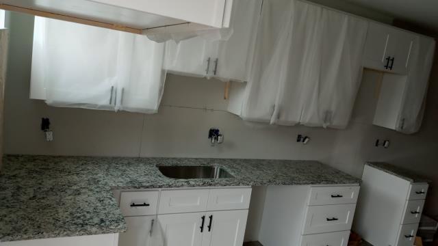 Baltimore, MD - Pleasant White shaker cabinets with Dallas White Granite countertops