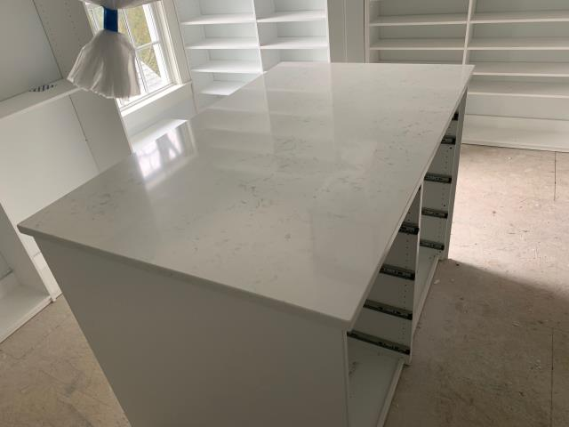Bethesda, MD - Quartz (QMSI Cashmere Carrara) countertops to complete your walk in closet