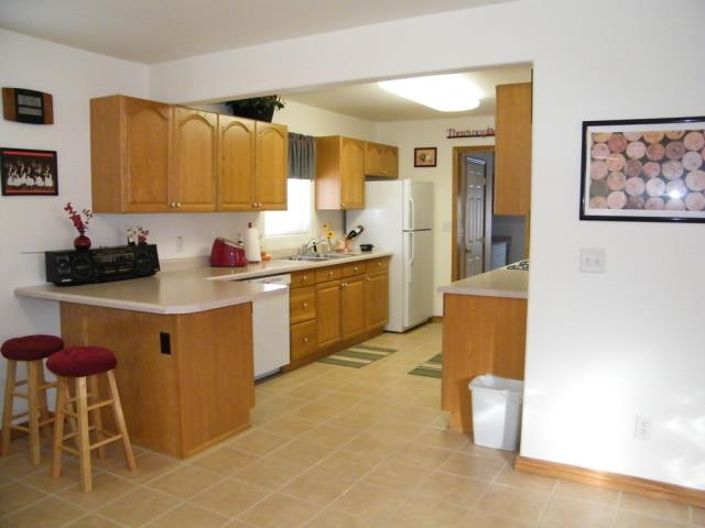 Ely, NV - 3 beds 1 bath 1,286 sq ft There's no place like home! Spectacular Tudor style home located in Murry Canyon. Freshly remodeled in 2006/2007 by a Nevada licensed contractor. Features 3 bedrooms, 1 full bath, oak cabinetry, loaded with appliances including washer and dryer, decorative lighting, carpet and tile flooring, breakfast bar, dining area, the living room features a propane flame fireplace, energy efficient vinyl windows throughout, low maintenance vinyl siding, architectural shingle roofing, 1 car garage, fenced yard, and propane forced air heat. This home is move-in ready and ready for you to enjoy! The HomeIsPossibleNV.org program is offering free down payment money to qualifying buyers.