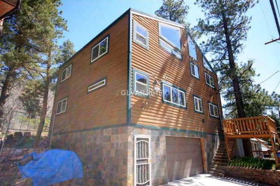 3 beds 2 baths 2,440 sq ft Spacious, rustic pine wood interior & windows define this lovely Mount Charleston NV mountain home. Picturesque views from the many windows. Super functional w/easy access plus a 2-car garage. Aprx. 1,000 sq.ft. luxury master suite w/cathedral ceilings, fireplace, whirlpool tub, sep. shower, dbl vanities, bidet, granite, custom fixtures & tile. Kitchen w/granite. Guest bath w/whirlpool tub, granite, updated fixtures. Slate stone on base of home.