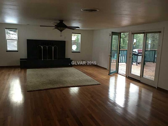 $349,000 2 beds 2 baths 1,568 sqft This is a beautiful Mt. Charleston home, located in Rainbow Subdivision, with awesome forest and mountain views. Main floor features a large, spacious living room with stunning hardwood flooring, recessed lighting, ceiling fan, propane fireplace with marble surround, numerous French doors with pleated shades and access to the exterior front and rear decks. Kitchen features custom cabinetry, marble countertops, recessed lighting and pantry/utility room. A dining area is open to the kitchen and living room. Relaxing master bedroom with knotty pine woodwork, recessed lighting, ceiling fan and spectacular views is located on the main floor. Romantic master bath features a jetted tub, walk-in closet and large view window. A den and upgraded guest full bathroom with custom tile, pedestal sink, custom lighting and laundry closet are also located on the main floor. Downstairs features a walk out basement with bedroom, den with perfect, large view window and a