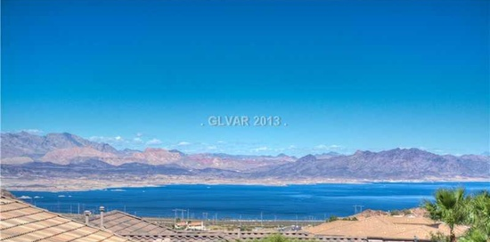$999,500 4 beds 3 baths 4,231 sqft AMAZING Custom Home in Lake Mead View Estates! HUGE RV / 6 Car Garage (47' deep X 29' wide). Two Residences in One - 1 Down & 1 Up with Separate Entrances! Downstairs Family Room with Kitchen & Large Bedroom. Upstairs has Lake & Mountain Views from Inside & Out. Open Floor Plan. AWESOME Home for Entertaining! Open Floor Plan, Incredible Kitchen, Balcony from Wrap Around Balcony with Stairs to the Pool Area. MUST SEE!