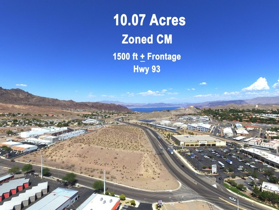 10 acres of prime commercial land located on US 93 in Historic Boulder City NV. This land consist of 2 parcels, one 6.5 acres and one 3.5 acres. Both being sold together, offering flexibility to buyers wishing to joint venture or partner with a developer. The property has all the utilities on site, with paved road frontage from Industrial to Canyon and a traffic count from 50,000 to 67,000 cars daily. Not surprising, since US HWY 93 is the interstate vehicles coming from Arizona into Las Vegas use.  The land is just minutes fron Lake Meade National Park, Hover Dam, the new bridge spaning the Colorado river and Historic boulder city. The property is zoned for commercial and light manufacturing (CM) and is ideal for possible uses, such as shopping center, convenience store, retail, restaurant, health club, hotel/motel, boat storage and sales as well as many other possibilities.  Priced right for quick sale at only 5 million or just under 11.50 per sq foot. Possible owner carry terms