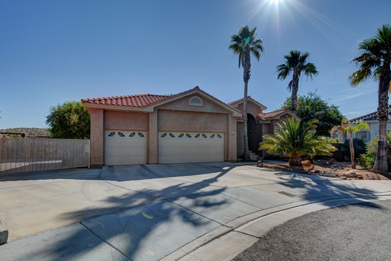 "Boulder City, NV - $674,000 5 beds 5 baths 3,430 sqft #lasvegas Home complete with ""mother-in-law"" kitchenette. Premium upgrades throughout this home. High Efficiency A/C with Electronic Air Cleaner, Tankless Water Heater, Water Softner, Garage has A/C & Heat. Pool, Spa and Outdoor Casita w/Built in Smoker, Refrigerator & Speakers. Extra Large RV Parking w/Full Hook-ups. Did you see the Travertine Floors. Unique floor plan with main level entry and walk out basement makes this home very energy efficient. Desirable Boulder City Neighborhood within walking distance to schools, library, golf course, etc No HOA!!!"