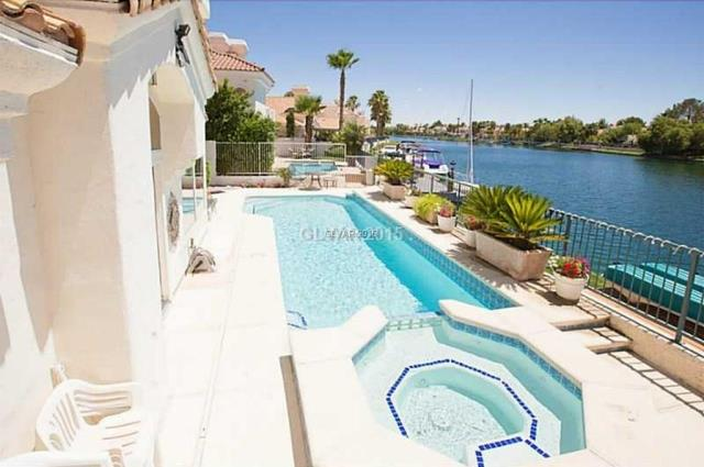 $674,000 4 beds 3 baths 2,588 sqft #lasvegas Waterfront property By Robert Ratliff and RE/MAX Las Vegas Ratliff Realty Group. Call 702-508-8262. This rare single story waterfront gem situated on the picturesque on the Lake Jacqueline in Desert Shores could be yours. This beautifully decorated home has soaring vaulted ceilings with expansive windows and stunning views of the crystal blue water, the Red Rock Mountains and incredible sunsets. You?ll enjoy the lakeside lifestyle not available to many in Las Vegas.  Great water and mountain views with sunsets that are gorgeous and panoramic. Rare single story waterfront property with pool and spa! Enjoy your backyard all year long.