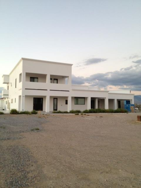 Pahrump, NV - $800,000  4 beds 7 baths 6,660 sq ft The entire house is porcelain tile for the flooring. Kitchen cabinetry done with no-VOC hardwood. Massive amount of space for a large family. Ten foot ceilings (12-ft in living room). Quiet street, nice neighbors.