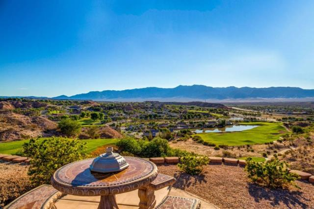 "$1,075,000  4 beds 3.5 baths 4,124 sqft Simply ""One Of A Kind View""....MOST OF THE FURNISHlNGS WILL BE LEFT IN THE HOME. (request exclusions list) Located on an elevated bluff overlooking the 11th fairway of The Palmer with 180 degree views of the city below and the mountains in the distance. Grand Outdoor Covered Patio looks out over the Pool and Spa that literally sits on top of the valley !!! ""Gorgeous Granite"" countertops enhance this Gourmet Kitchen with GE Monogram Refrigerator, Seperate Freezer and ""Gas Burning Stove"". Kitchen also has ""another"" Advantium Speed Cook Oven and Advantium Microwave. Theatre Room is state of the art. Great Room has floor to ceiling picture windows that showcase 180 degree views of the valley, along with a fireplace that is accented by flagstone wall to wall. Master Suite has unending views of the valley below with walk-in tiled shower, sunken Jacuzzi tub, separate His & Hers Vanities, wall mounted TV,, . Casita has views down the 10th fairway of the"