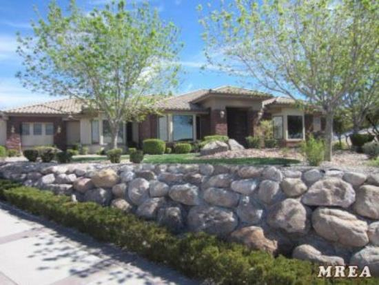 Custom home with helicopter pad and private hanger is truly a one of a kind property. The 3/4 acre, fenced estate is located at the NW edge of Mesquite Nevada, next to BLM land.