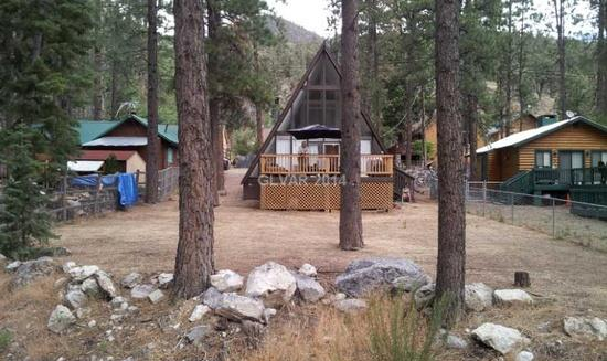 Mount Charleston home for rent upgraded throughout!  A-frame wall of windows with great forest & mountain views. 2 beds, 2 baths, 1,472 sq ft $1,400/mo