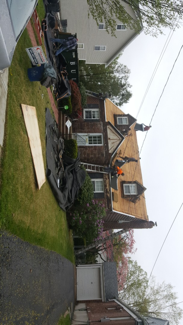 River Edge, NJ - Checking in on the progress of a new Gaf Timberline roof installation and  Mastic Ovation vinyl siding installation started today.